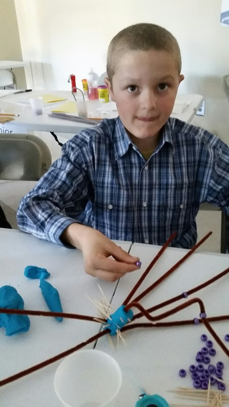Gideon making a bacteria model