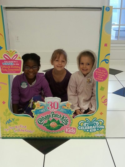 Little Girls in a Cabbage Patch Doll Box