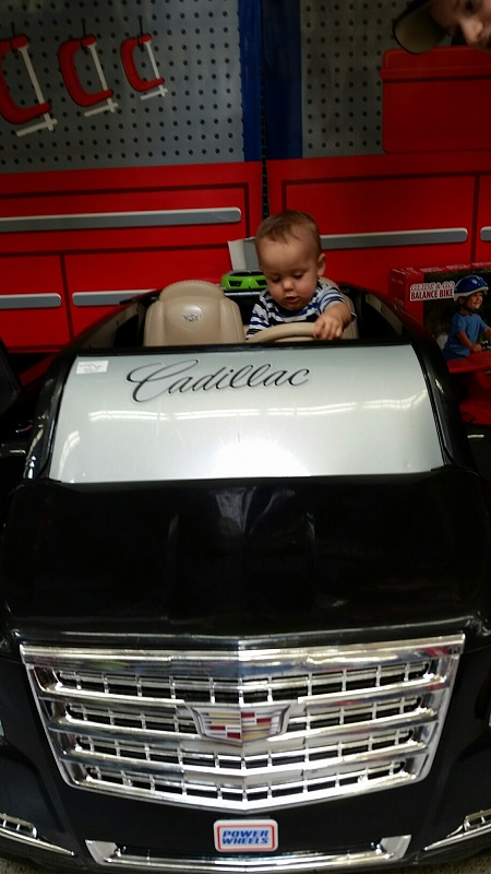 Micah in a Cadillac